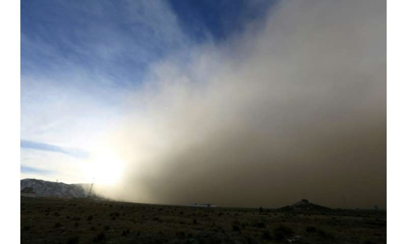 The sandstorm is seen rolling into Zhangye in China's northwestern Gansu province