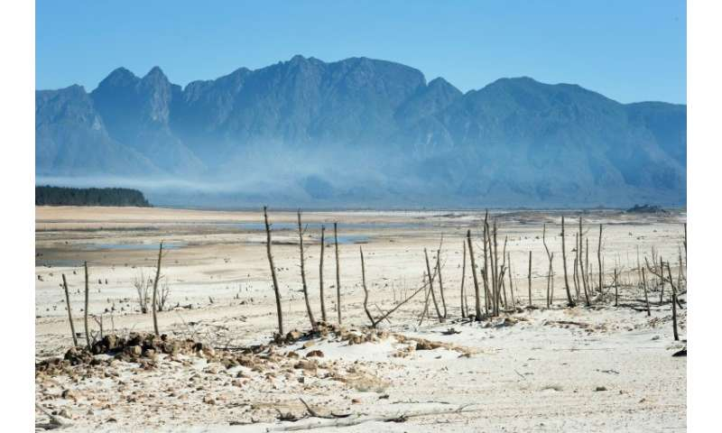 The Theewaterskloof Dam, one of Cape Town's major sources of water, is now a landscape of sand and desiccated tree trunks