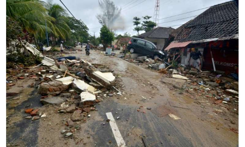 The tsunami left a trail of destruction in Carita, destroying buildings and tossing cars aside