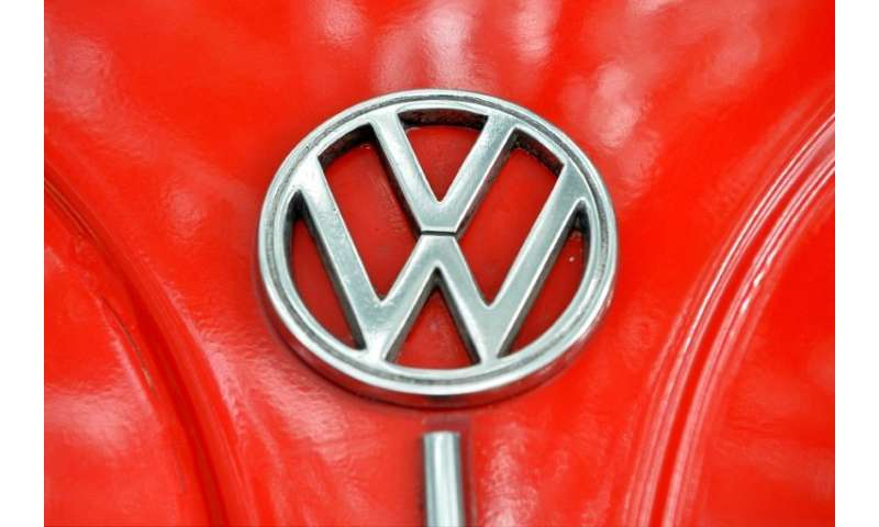 """The Volkswagen logo is seen on the bonnet of vintage Beetle. Mexican farming communities accused VW of """"arbitrarily"""" p"""