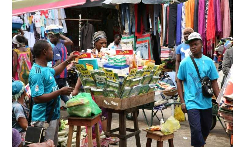 This market stall on a Libreville street is piled high with rat poison, but some vendors readily sell kobolo under the table—a c