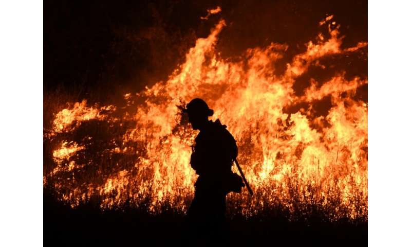 Thousands of firefighters are struggling to contain numerous wildifres in California, where two of their number and four civilia
