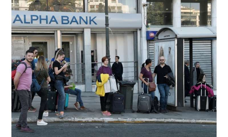 Tourists faced a wait for airport buses in central Athens during a strike by taxis and suburban