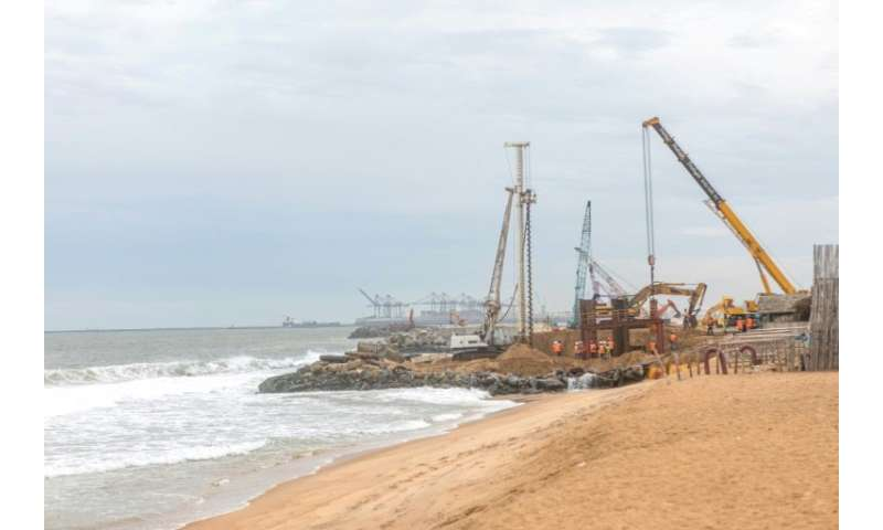 Villagers living along Togo's shoreline say construction of a new deep water port in Lome has stept up the pace of the coastal e