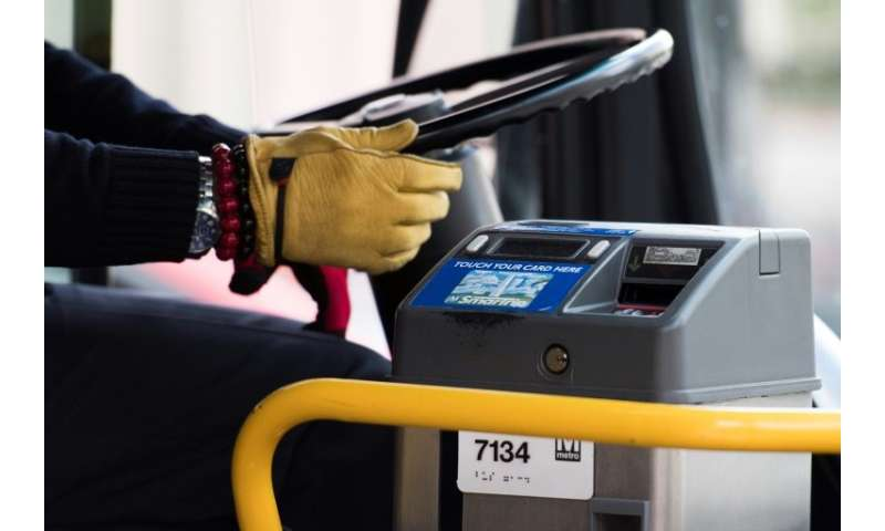 Washington's bus operator is exploring the cash-free concept as a means of slashing passenger boarding times