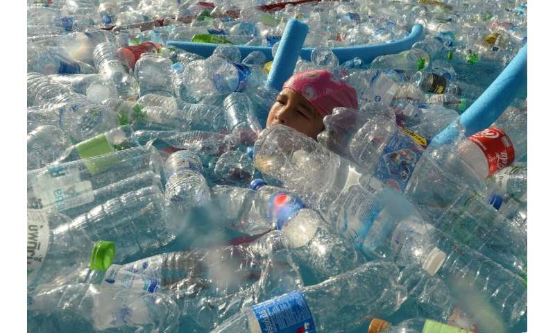 A child in Bangkok, Thailand swims in a pool  filled with plastic bottles during an awareness campaign to mark World Oceans Day
