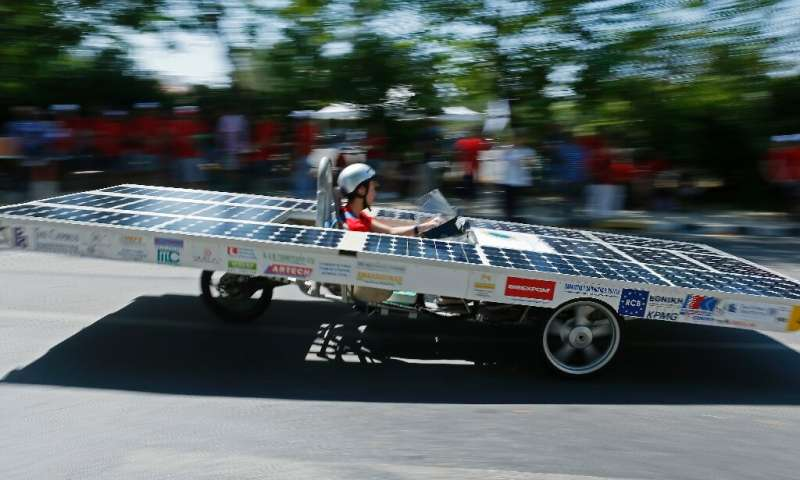 A Cypriot competitor steers his solar car during the Cyprus Institute's solar car challenge in Nicosia on June 23, 2019