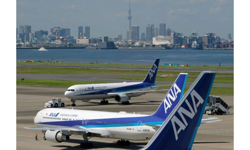 ANA Holdings said it would buy 30 Boeing and 18 Airbus planes, citing growing demand in the region and increased inbound tourism