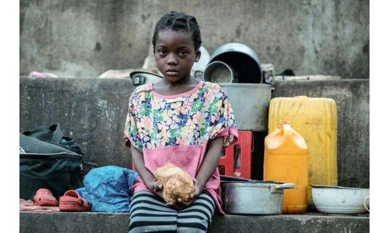 Elena Joaquin, 6, sits in a shelter in Buzi, Mozambique