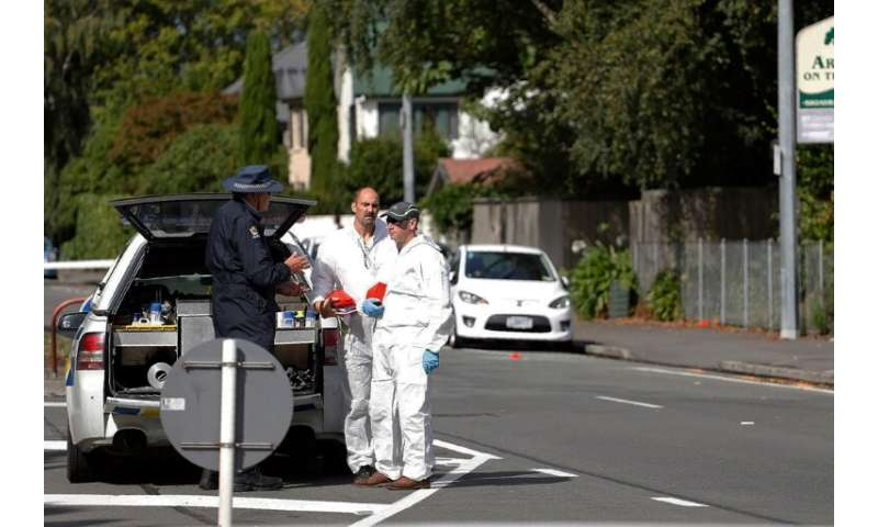 Forensic experts collect evidence near one of the attacked mosques in Christchurch