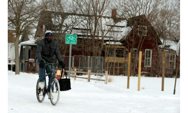 Jerry Jackson rides his bike in Detroit, Michigan—the state has declared a emergency in view of the frigid temperatures