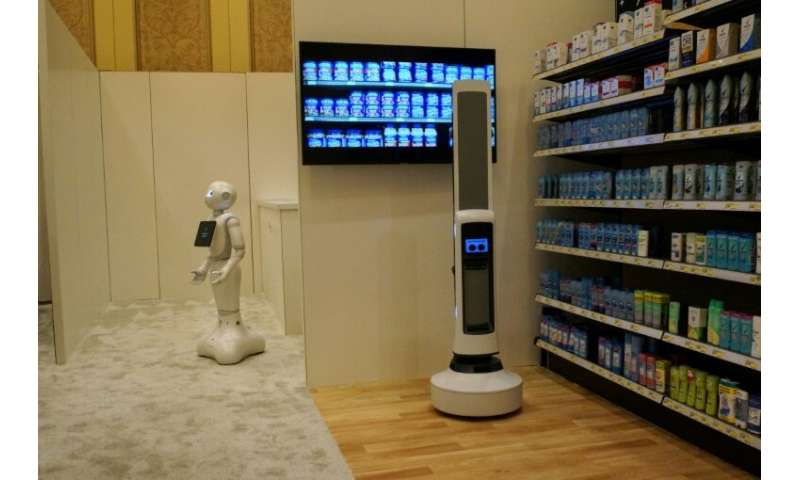 Pepper of SoftBank Robotics (L) and Tally of Simbe Robotics (R) are teaming up to work with retailers: Pepper interacts with cus