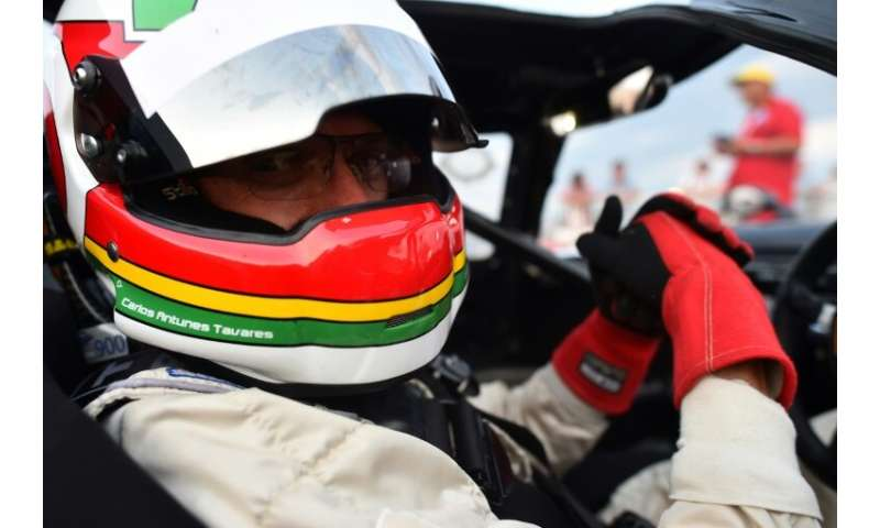 PSA chairman Carlos Tavares, pictured in his a 1966s Lola T70 MKIII in 2018, announced that the plans to sell Peugeot autos in t