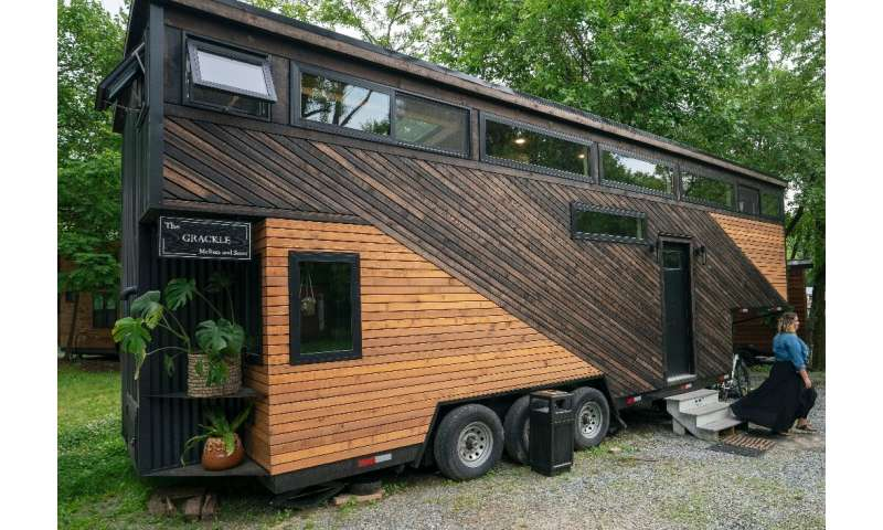 Scott Berrier's tiny home, known as Grackle, is on wheels—his wife Melissa is pictured outside