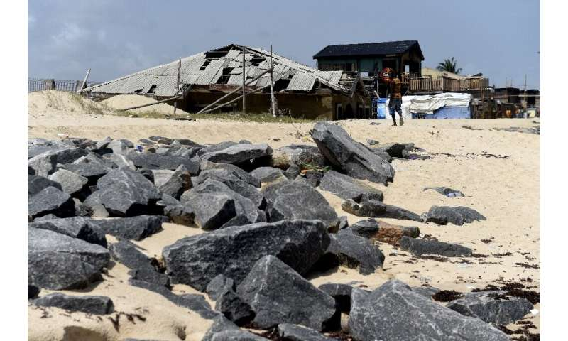 Some  homes have been completely burrowed in sand at Alpha Beach