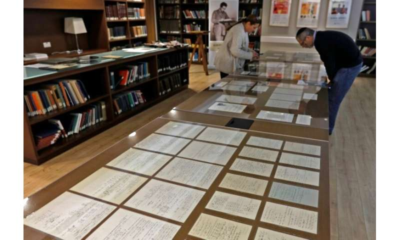 Visitors look at some of Albert Einstein's manuscripts on display in the Jerusalem's Hebrew University of Jerusalem