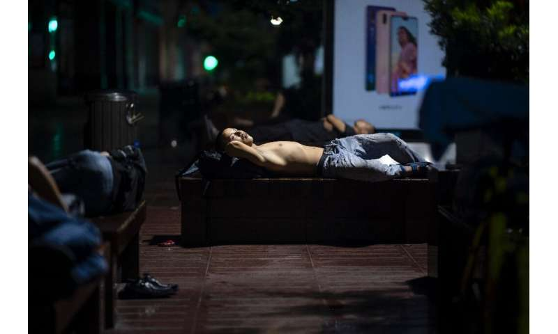 When temperatures climb in Shanghai, residents are known to sleep on  benches along Nanjing East Road, a popular pedestrian stre