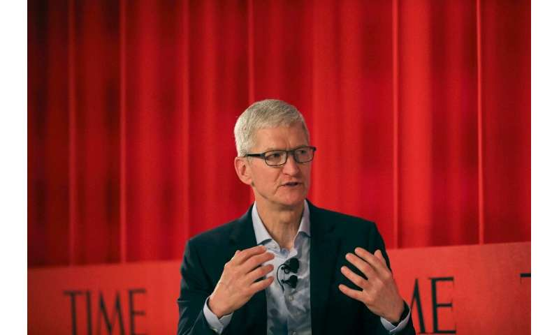 Apple CEO Tim Cook said he remained upbeat on China, despite weaker sales in recent quarters in the region