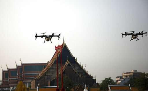 Bangkok flies drones, warns of hardships in bad air battle
