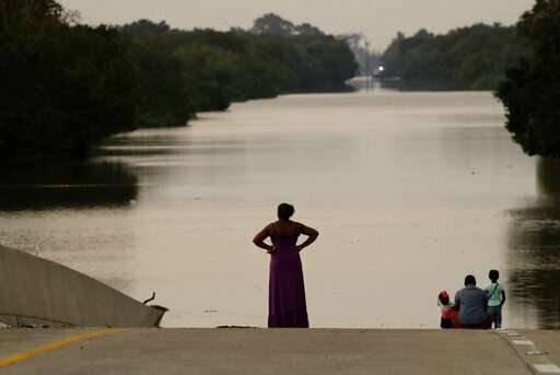 AP-NORC Poll: Disasters influence thinking on climate change