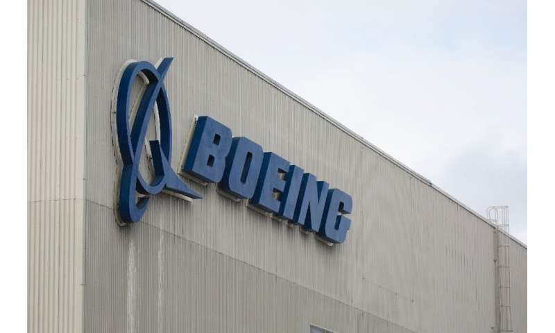 Boeing reported a drop in first-quarter profits due to increased costs associated with the 737 MAX grounding
