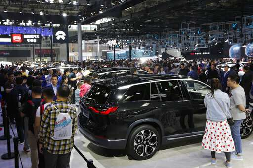 China's auto show highlights electric ambitions