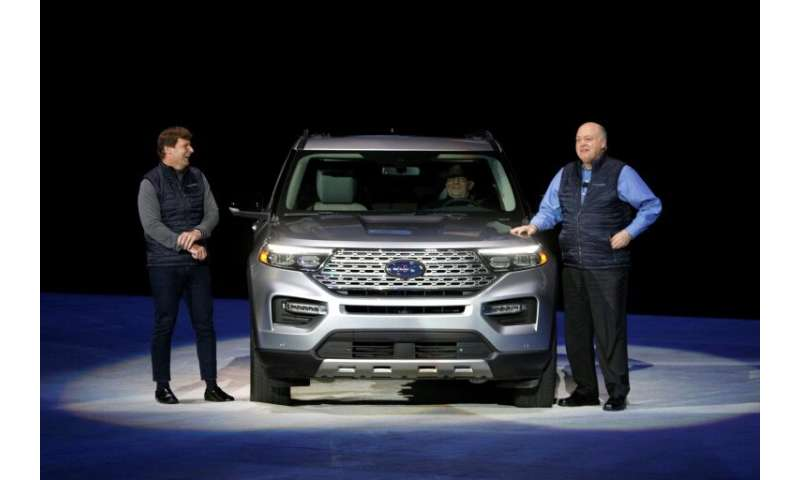 Ford CEO Jim Hackett (R), Jim Farley, president of global markets, unveiled the 2020 Ford Explorer SUV, part of its restructurin