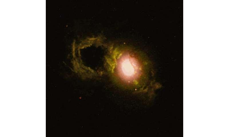 SDSS J1430+1339: Storm rages in cosmic teacup