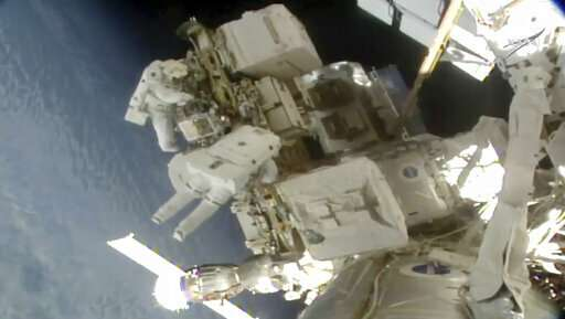 Spacewalking astronauts replace more station batteries (Update)