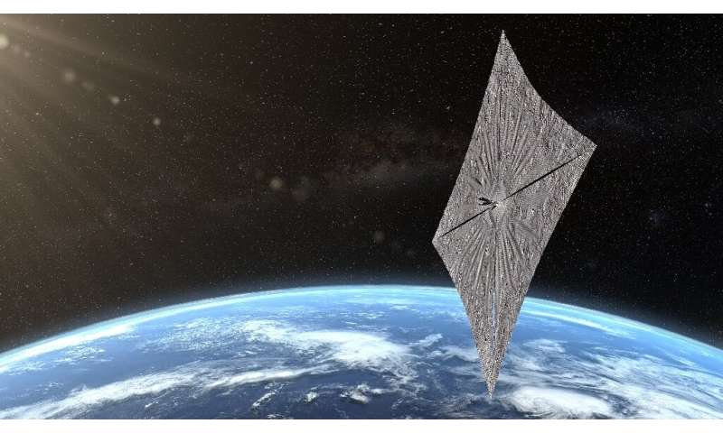This image, issued by the Planetary Society, shows the artist's concept of LightSail 2 over the Earth