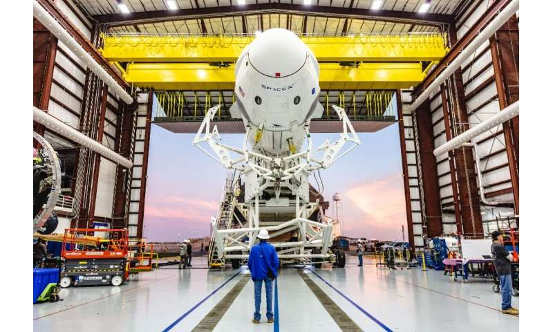 A SpaceX Falcon 9 rocket with the Crew Dragon capsule attached