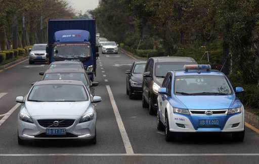 Giving up gas: China's Shenzhen switches to electric taxis