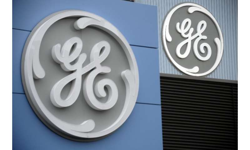 General Electric raised its full-year profit forecast despite reporting a second-quarter loss