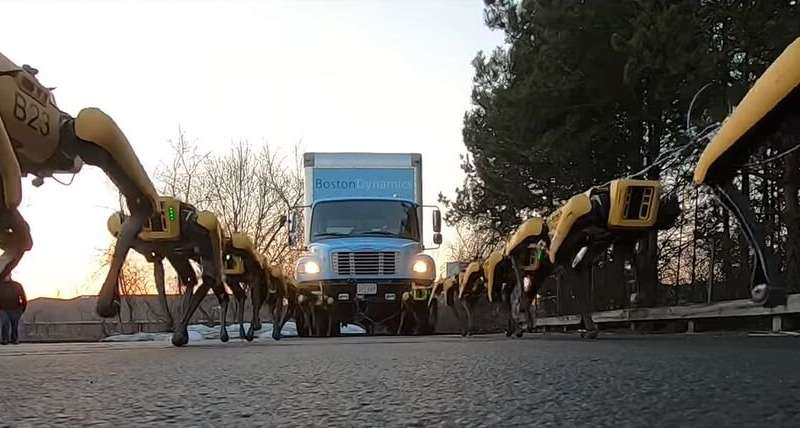 **Team of SpotMini robots pull a box truck up a hill