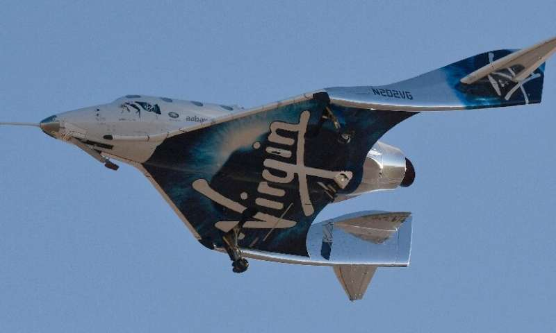 Virgin Galactic's SpaceshipTwo-class VSS Unity comes in for a landing after its suborbital test flight on December 13, 2018, in