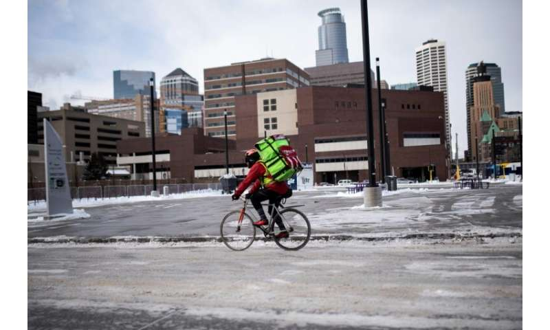 A bicyclist braves the cold in downtown Minneapolis, Minnesota
