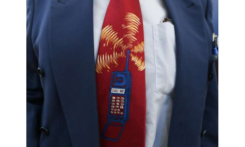 A bidder wearing depicting a ringing mobile phone at the start of Germany's auction for the construction of its ultra-fast 5G mo
