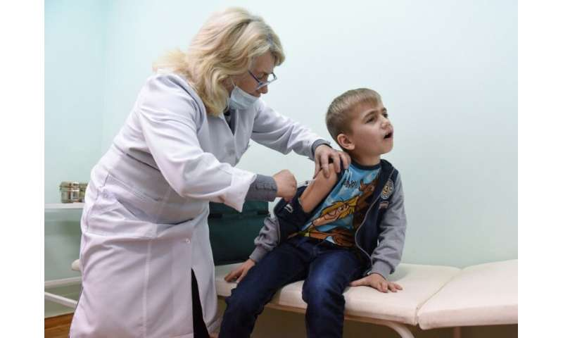 A boy is vaccinated for measles in the village of Lapaivka near the western Ukrainian city of Lviv