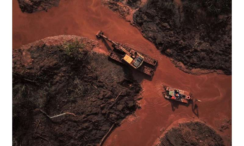 Aerial view of emergency crews picking through the mud looking for bodies, 99 days after the collapse of a tailings dam January