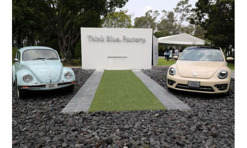 """A final edition (right) of the Volkswagen """"Beetle"""" is seen next to a last edition of a previous model of the iconic ca"""