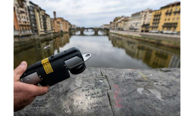 A latest-generation infrared wand is being used to remove graffiti spoiling the city of Florence