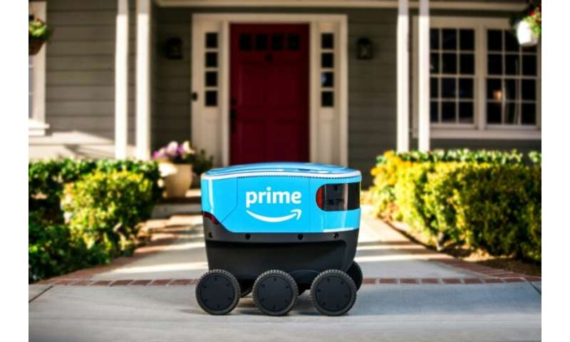 "Amazon's new autonomous delivery robot called ""Scout,"" seen in a company photo, began delivering packages to customers"