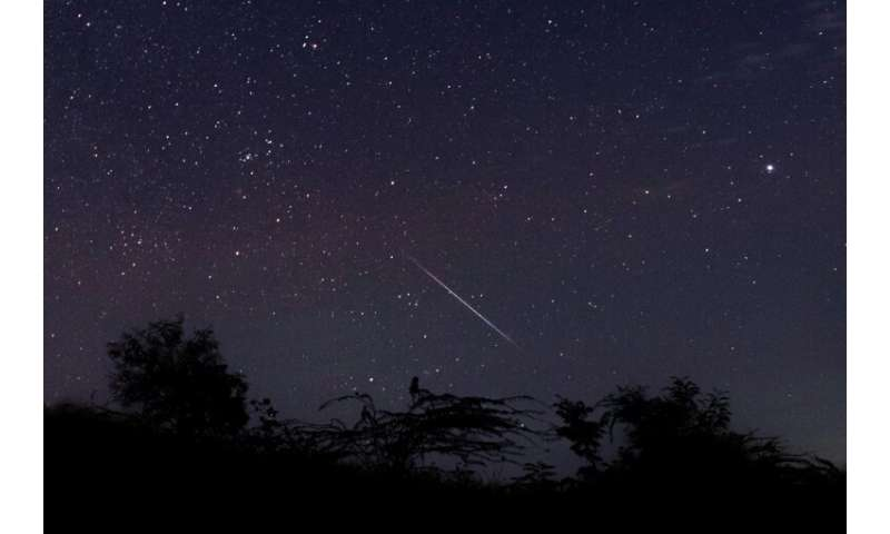 A meteor streaking through the night sky over Myanmar during the Geminid meteor shower on December 14 2018.