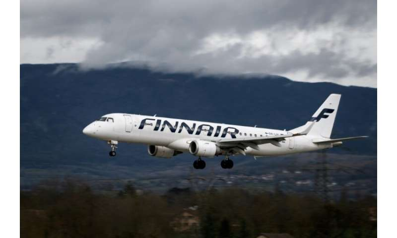 An Embraer 190 commercial plane with registration OH-LKI of Nordic carrier Finnair is seen landing at Geneva Airport on March 11