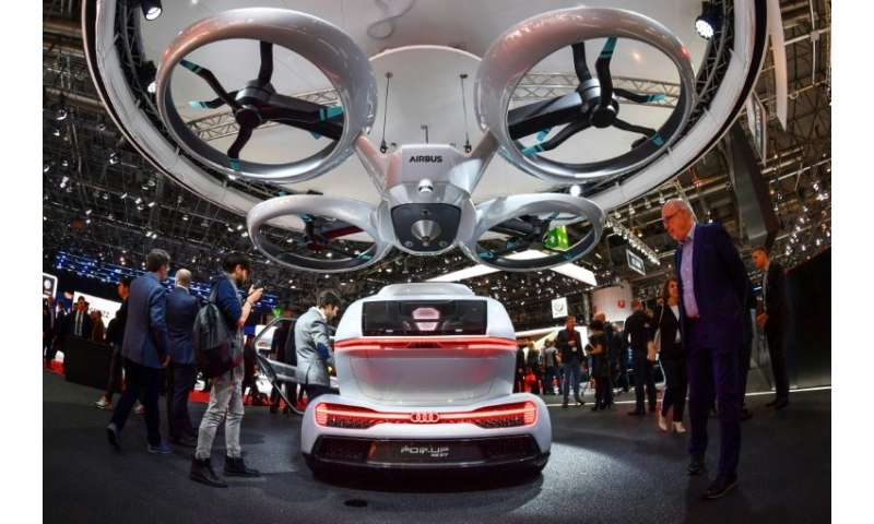 "A number of designs for flying cars have been unveiled including the ""Pop.up next"" by Audi, italdesign and Airbus seen"
