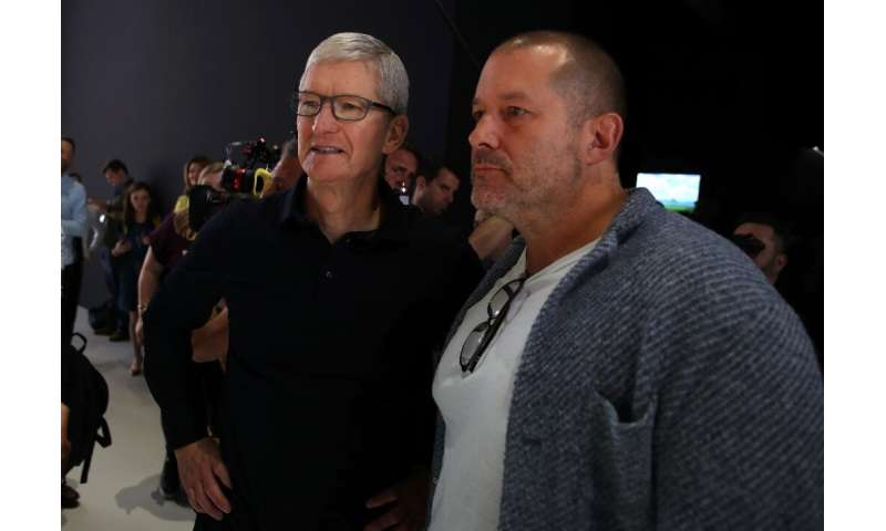 Apple chief design officer Jony Ive (R), seen with CEO Tim Cook at the 2019 Apple Worldwide Developer Conference, is leaving the