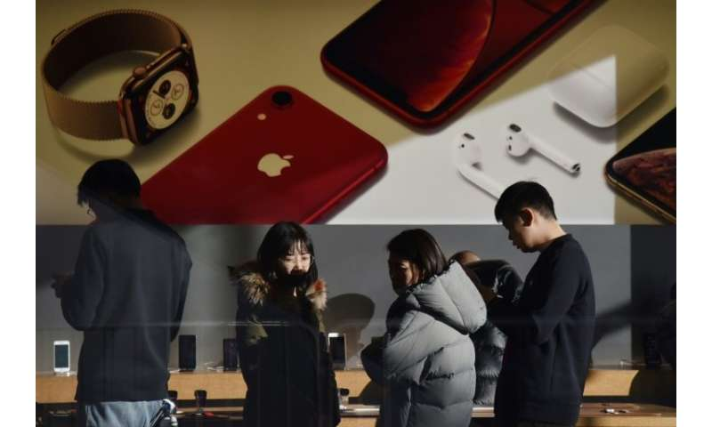 Apple stores in China have continued with business as usual despite a Chinese court-ordered ban on iPhone sales that could hurt