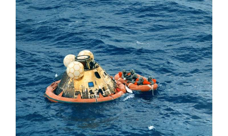 Astronauts Neil Armstrong, Michael Collins and Buzz Aldrin waited in the Hawaii sea on 24 July 1969 to be picked up after the hi