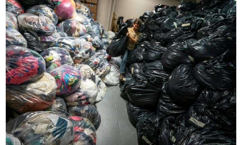 At Fabscrap's Brooklyn warehouse, employees and volunteers sort through huge bags of fabric scraps—which are then recycled, shre