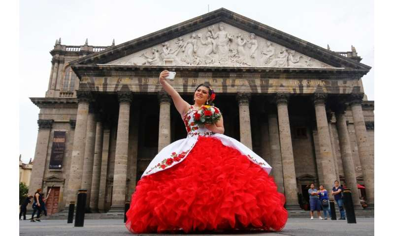 A tourist takes a selfie in front of the neoclassical Teatro Degollado in Guadalajara, Mexico—experts warn the fun can turn sour